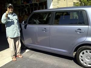 Dad posing with his car